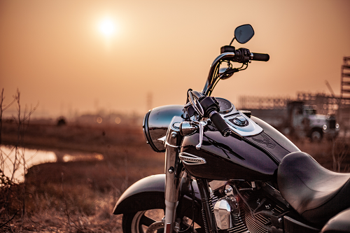 motorcycle in front of a sunset